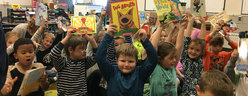 Mrs. Legg and her students  love their new books!  Thank you Dr. Couch and Scholastic! slideshow image